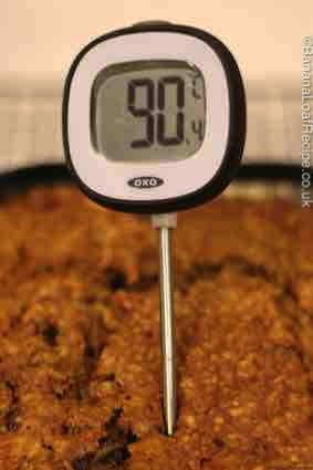 Using a thermometer to test if your cake is cooked
